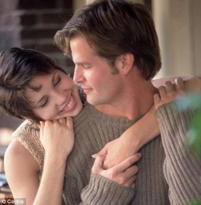 Couple embracing.