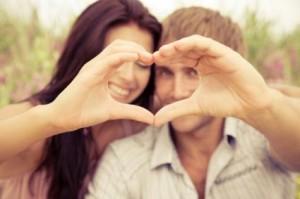 Couple making a heart.