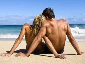 Sexy couple on beach.