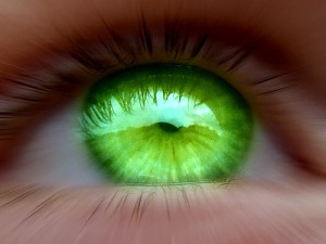 A green eye to signify jealousy.